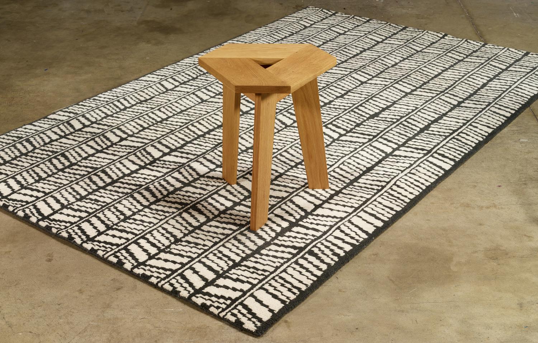 Wolfum rampli rug with tri stool