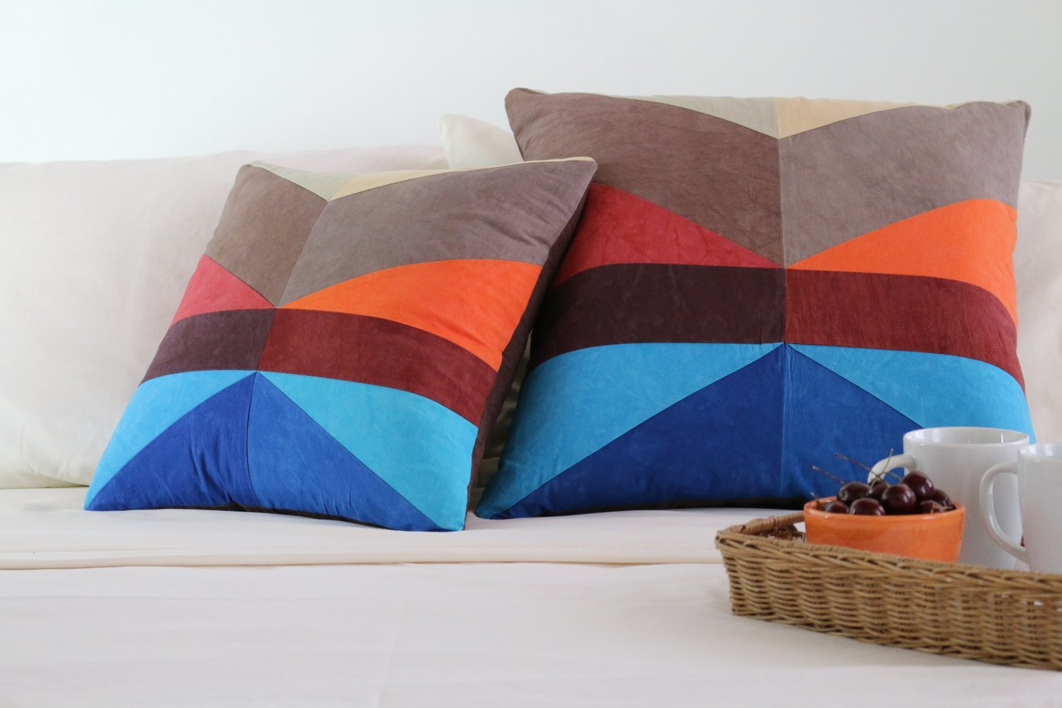 Two maritime throw pillows on bed with tray studio dunn