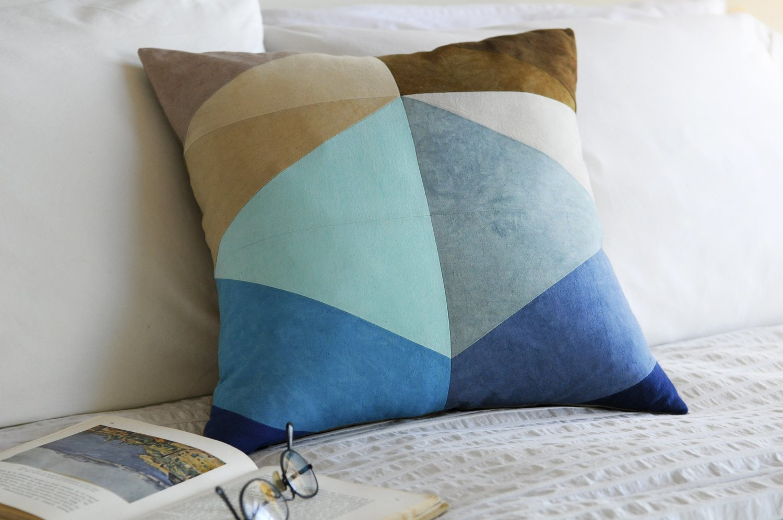Shoreline throw pillow bed with book studio dunn