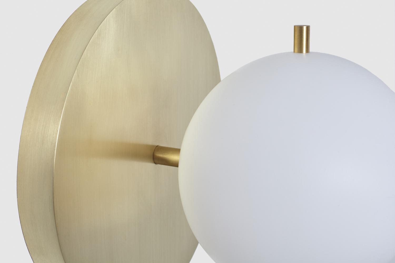 Signal sconce hewn brass globe detail