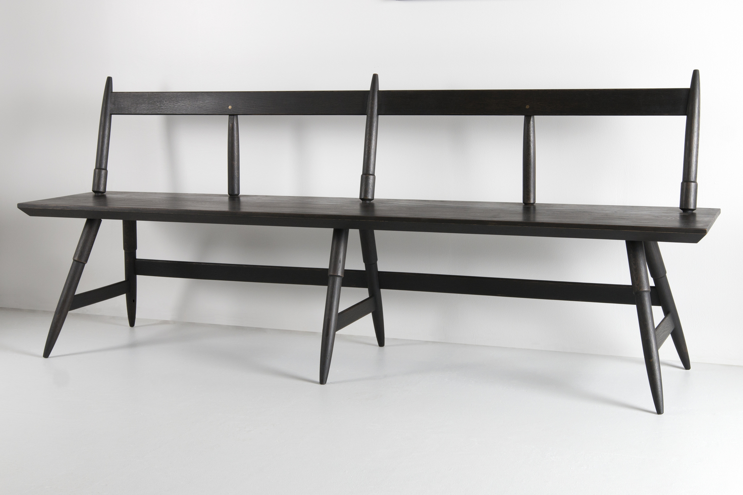 Rockport bench seasoned black at angle studio dunn