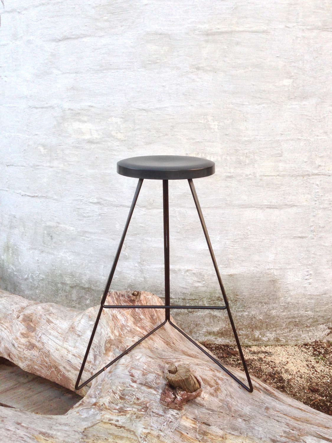 Greta de parry coleman bar stool black and black on log