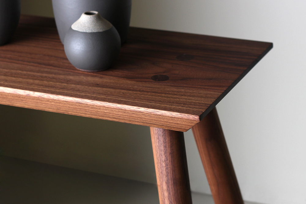 Rockport console table walnut top detail with vases studio dunn