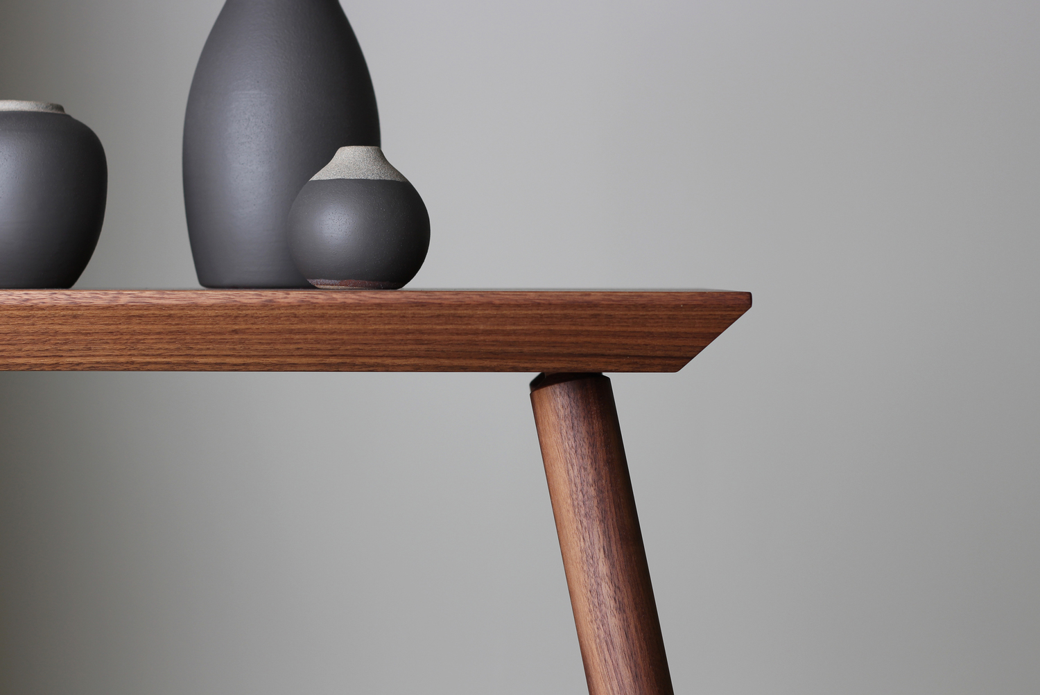 Rockport console table walnut side detail with vases studio dunn